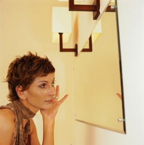 Mature_Woman_Looking_In_Mirror